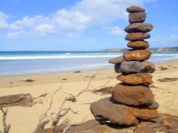 rock cairn by ocean