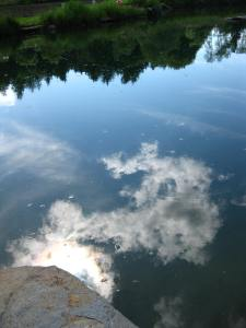 clouds reflected in pond