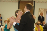 The groom dances with his mom