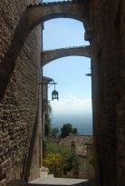 Assisi through typical city arch