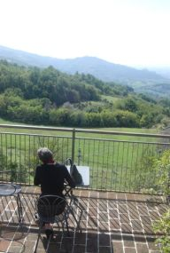 writing on the terrace facing Assisi