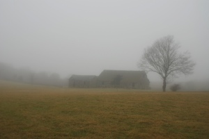 old barn in the mist