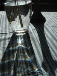 sun through water and glass