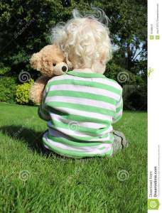 child-cuddling-teddy-bear-16188541